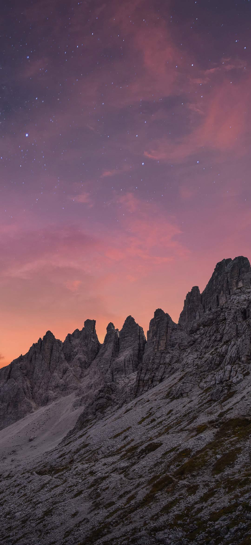 Gray mountain at night