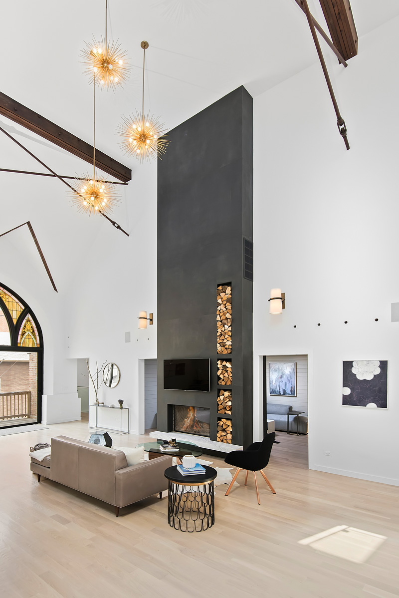 Fireplace in moern living room in Church conversion to chic private home Chicago