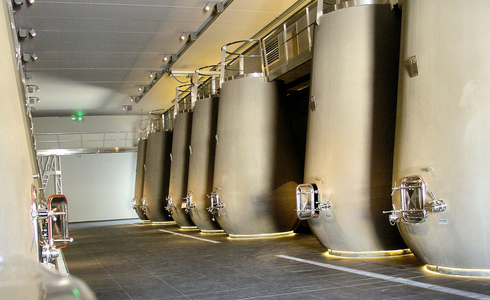 100-hectoliter concrete vats line both sides of the room at the chateau. Each contains 2,642 gallons of wine!
