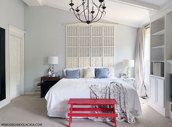 white shabby chic bedroom with red bench