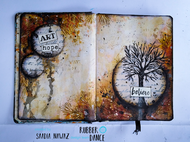 A journal spread with Rubber Dance stamps and acrylic paints