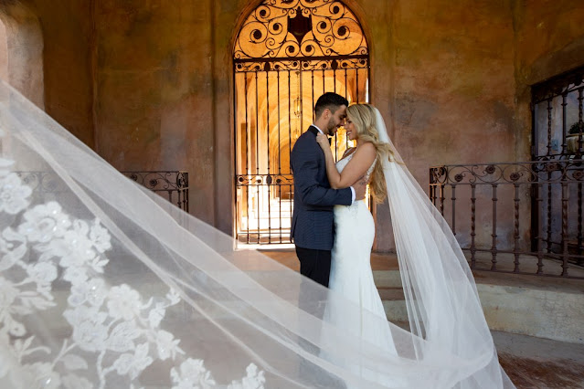 groom and bride with long veil
