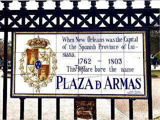 Replica of Colonial-era signage at the entrance to Jackson Square in New Orleans