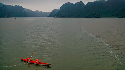 Kayaking is just one of the few activities you could do while on a Halong Bay cruise