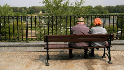 Old couple sitting on a bench picture