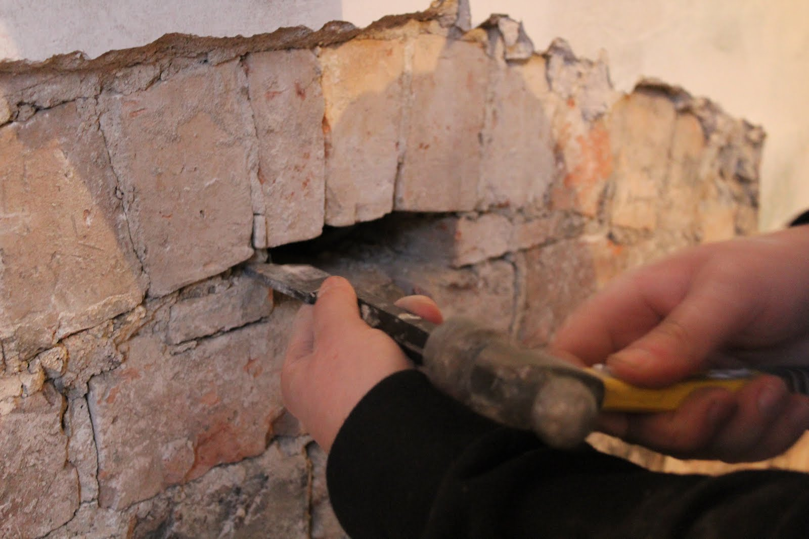 how to remove bricks beneath arch