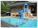 Outdoor pool waterslide and kids splash pool in Gatlinburg