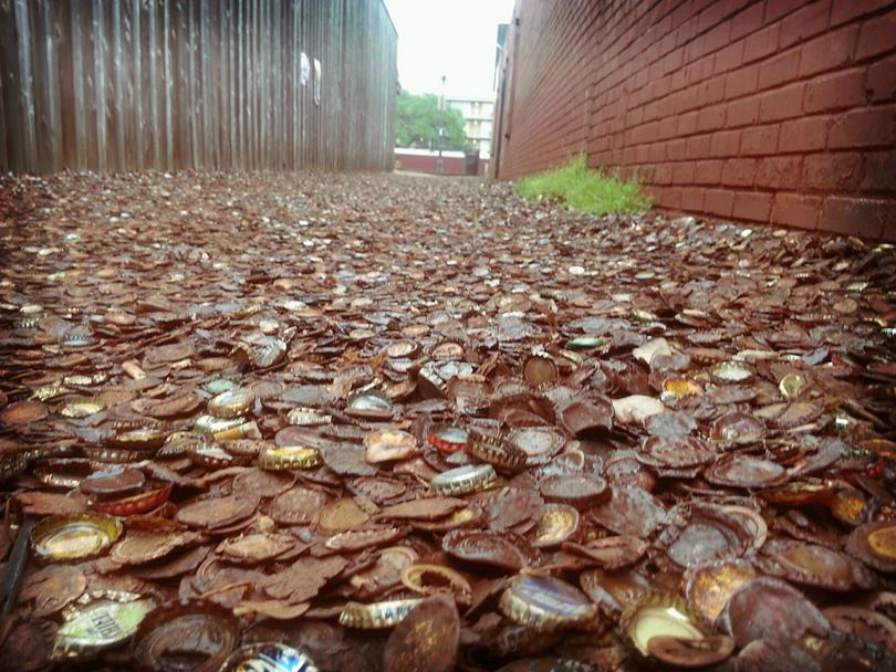 Bottle Cap Alley, a street paved with around four decades of discarded beer and soda bottle caps. An alley in Texas, USA, has become famous and attract lots tourist