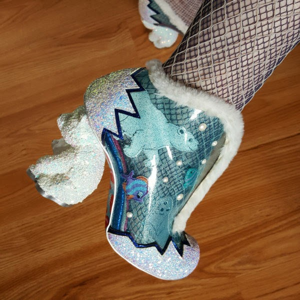close up of white polar bear heel shoe with applique sea animals and translucent uppers