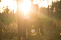Woman in sunlight by Photo by Natalie Grainger on Unsplash