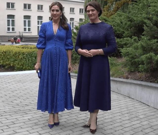 Crown Princess Mary wore a willow cobalt dress by Cult Gaia. Prada blue satin clutch. Diana Nausėdienė
