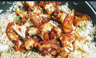 Adding fried cauliflower florets with rice for cauliflower Manchurian fried rice recipe