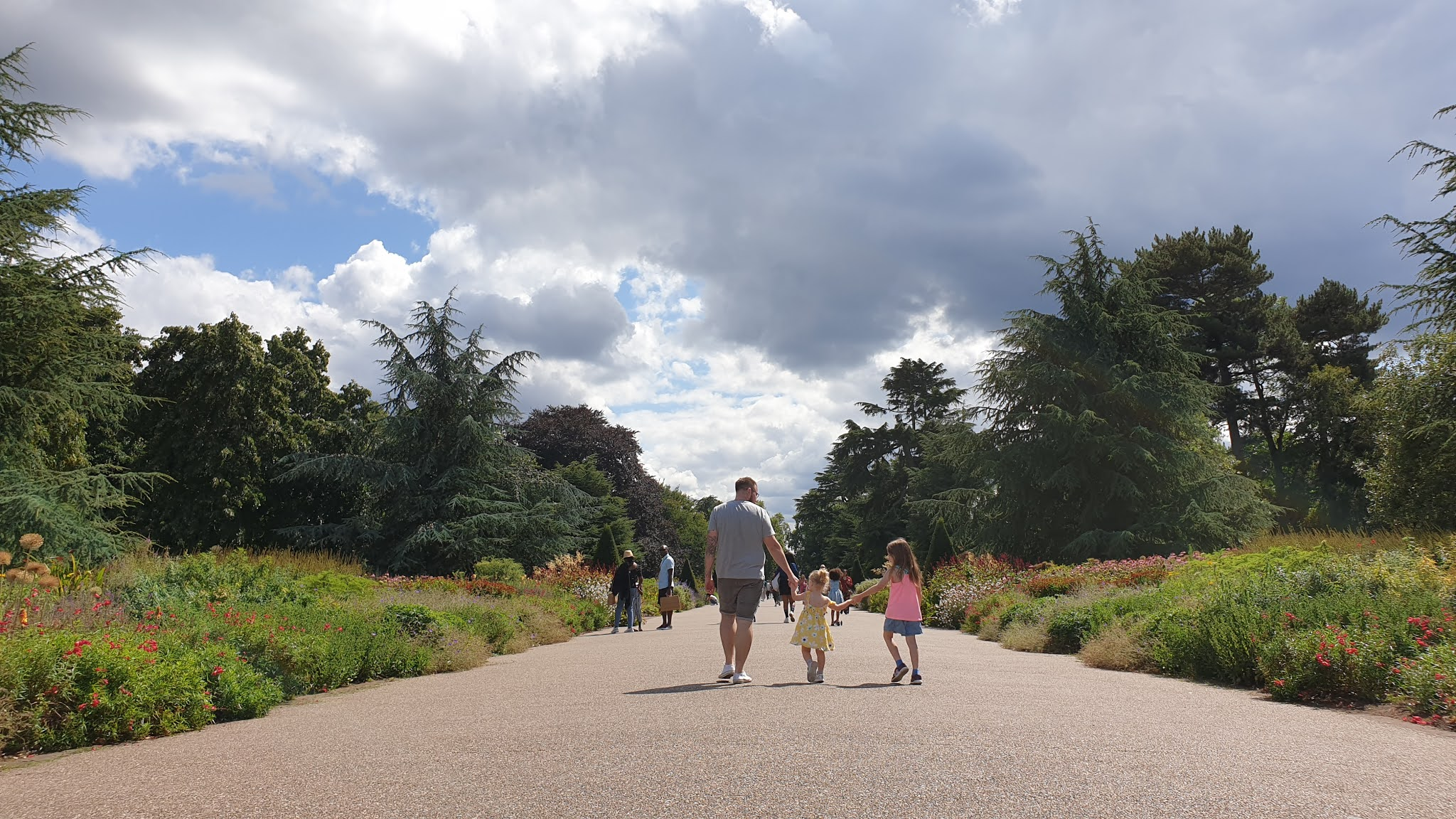 family walking at kew gardens