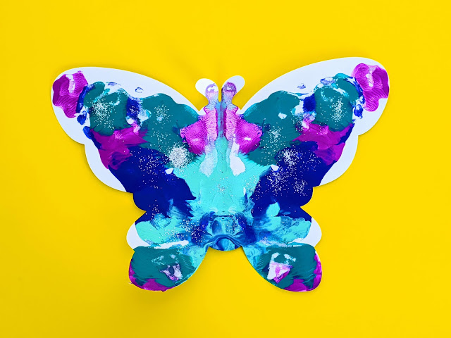 Colorful butterfly symmetry art activity for kids