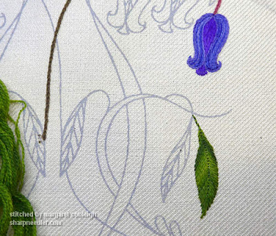 Starting to stitch: bluebell in purples and blues and a leaf in variegated green crewel wool