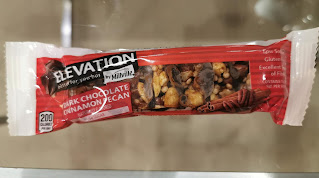 A single individually wrapped bar of Elevation by Millville Dark Chocolate Cinnamon Pecan Nut & Spice Bar