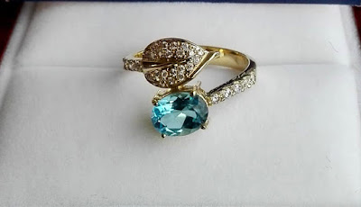 blue topaz set in engagement ring