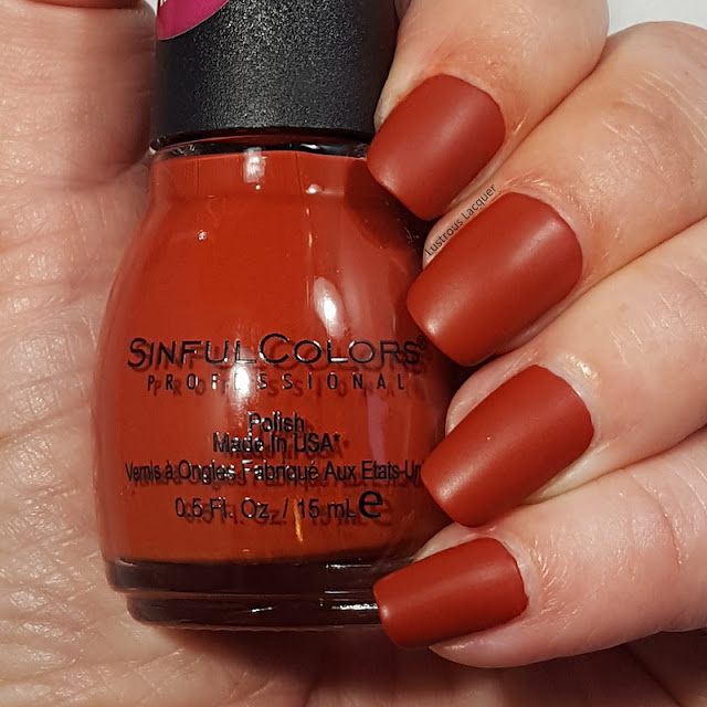 Rusty orange colored nail polish with a matte finish