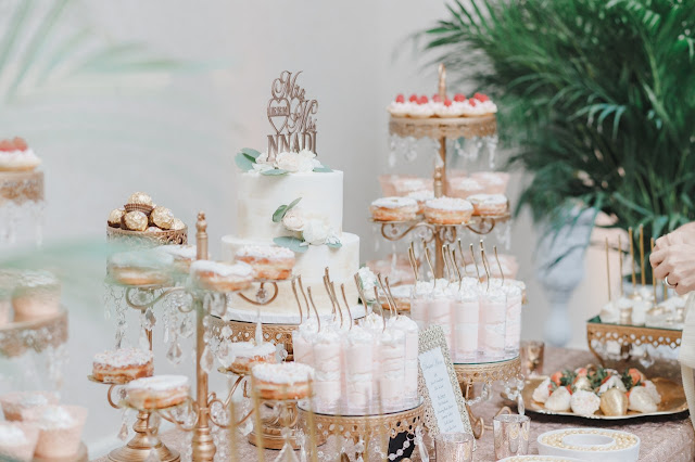 gold wedding reception dessert and cake display