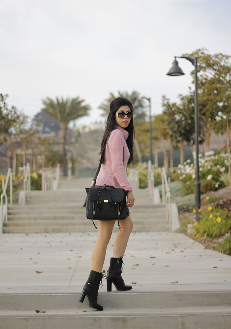 Adrienne Nguyen_Invictus_Fuzzy Pink Turtleneck Sweater with Quilted Black Leather A Line Skirt and Leather Lace UP Combat Boots