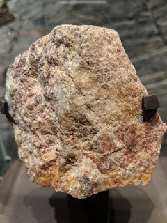 Quartz pebble conglomerate from Australia containing 4.276-billion-year-old zircon crystals, American Museum of Natural History, New York, New York