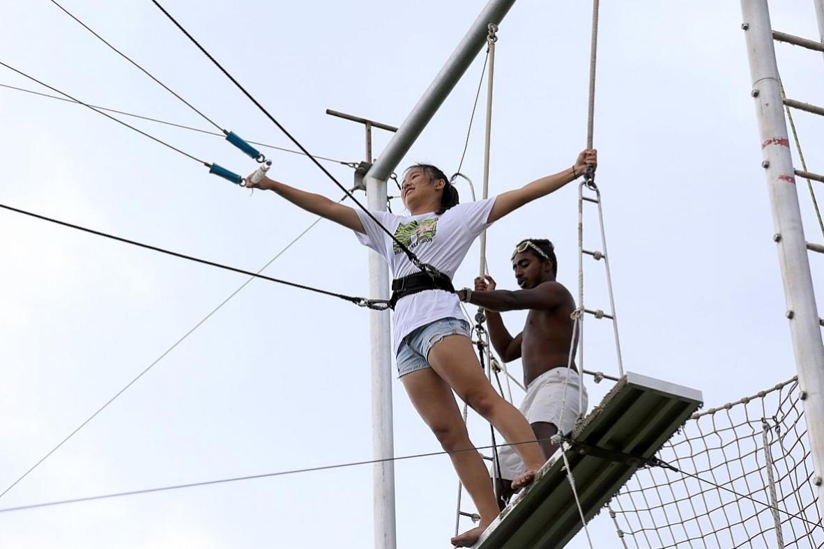 Miss Janel Chee participating in the flying trapeze, an activity at Club Med Albion.