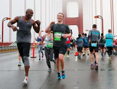 Mark Zuckerberg and  Nigerian-born Facebook Executive, Ime Archibong on marathon race