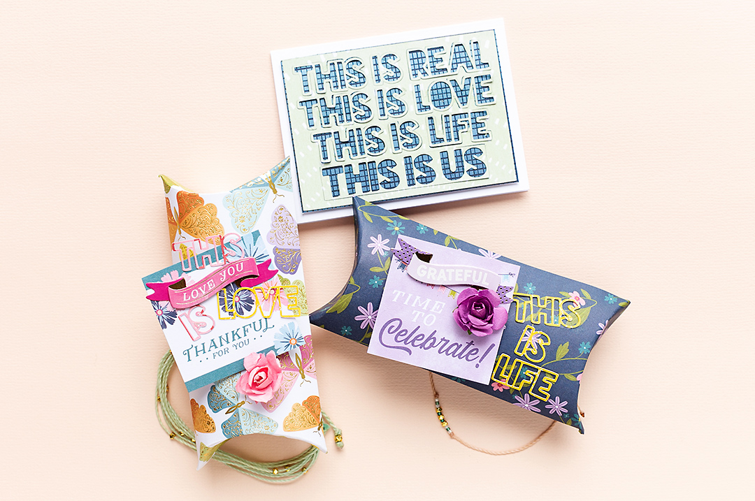 A cute gift wrapping set with pillow boxes, the This is Us cut file and the Wonders Collection by Paige Evans. Mojosanti Sandra Dietrich American Crafts