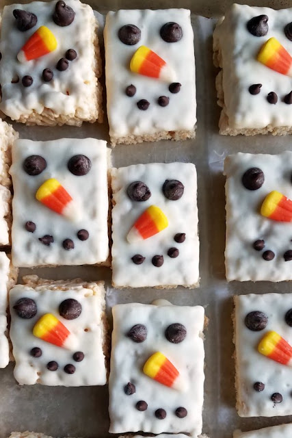 Tray of white chocolate dipped snowman rice krispie treats