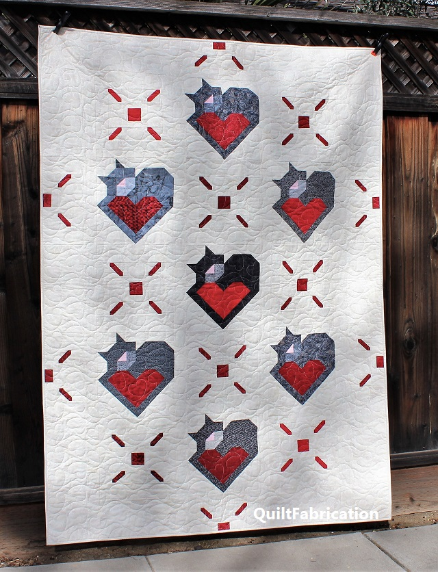 Wrap Up Some Love lap quilt by QuiltFabrication
