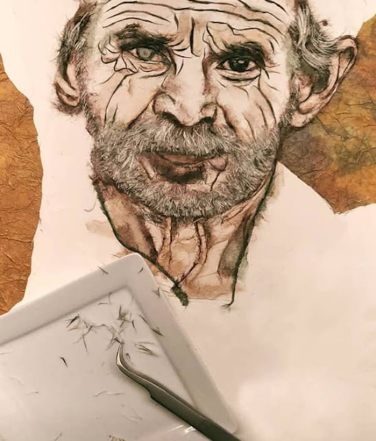 male portrait in progress with tweezers and tiny paper fibers