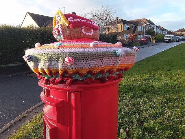 Gingerbread house knitted postbox topper