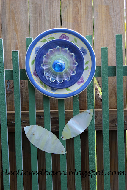 Eclectic Red Barn: Blue Plate Flower with soda can leaves
