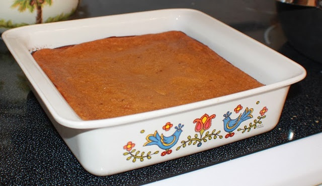 this is homemade pumpkin puree custard in a square corning ware dish with bluebirds on it