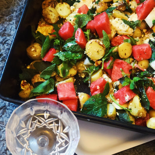 ROAST GARLIC AND OREGANO POTATOES WITH TWO KINDS OF WATERMELON, FETA, HALLOUMI, FRESH HERBS AND A...