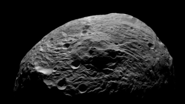 Asteroid Vesta originates from a cosmic 'hit-and-run' collision