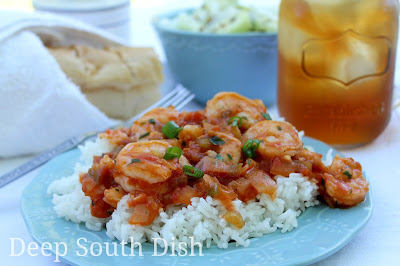 Fresh shrimp, cooked in a spicy Creole tomato sauce and served over a bed of hot steaming rice. Served here with my cucumber and onion salad, sweet tea and hot French bread.