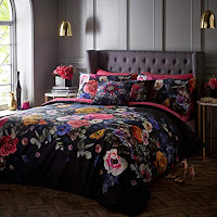 grey bedroom with navy bedding with pink flowers