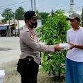Puluhan Tukang Becak di Bukateja Dapat Nasi Kotak Dari Polisi