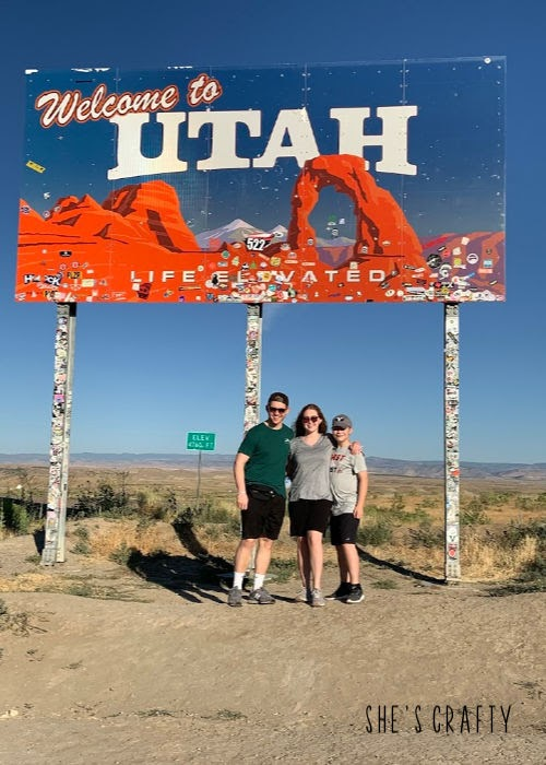 8 road trip myths and easy solutions for your travel - my kids aren't good travelers - welcome to utah sign