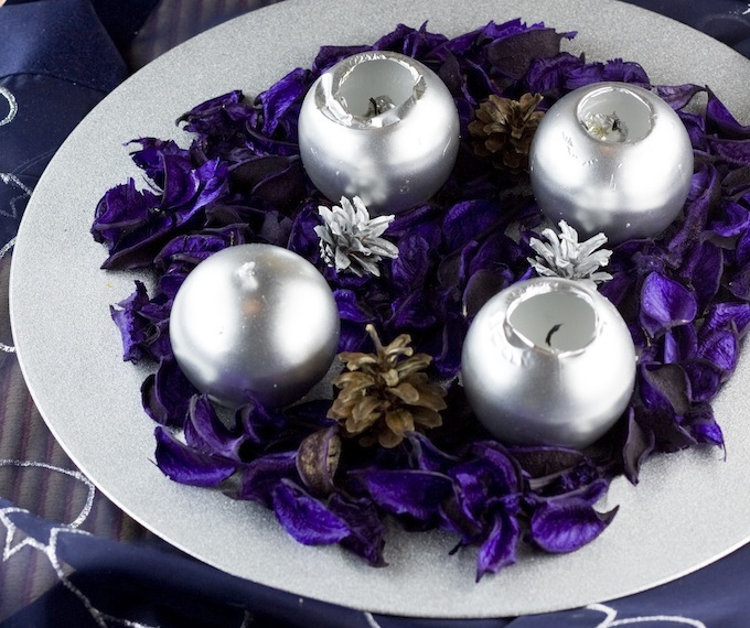 silver christmas ball candles in a wreath