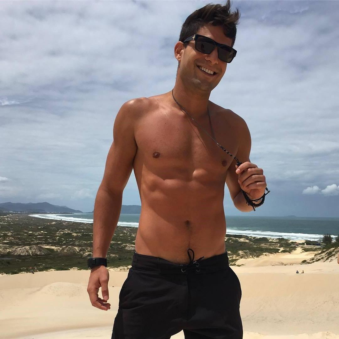 shirtless-fit-beach-dude-naughty-smile-sunglasses