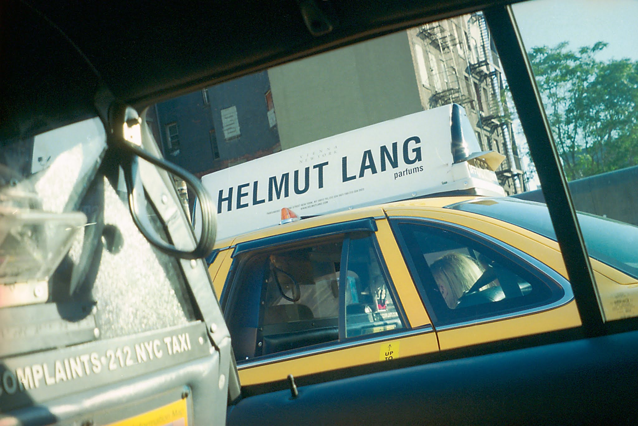 A taxi with a Helmut Lang advertisement in the year 2000, from Iain R. Webb's book, 'Postcards From the Edge of the Runway.' | NYC, vintage, aesthetic, inspiration | Allegory of Vanity