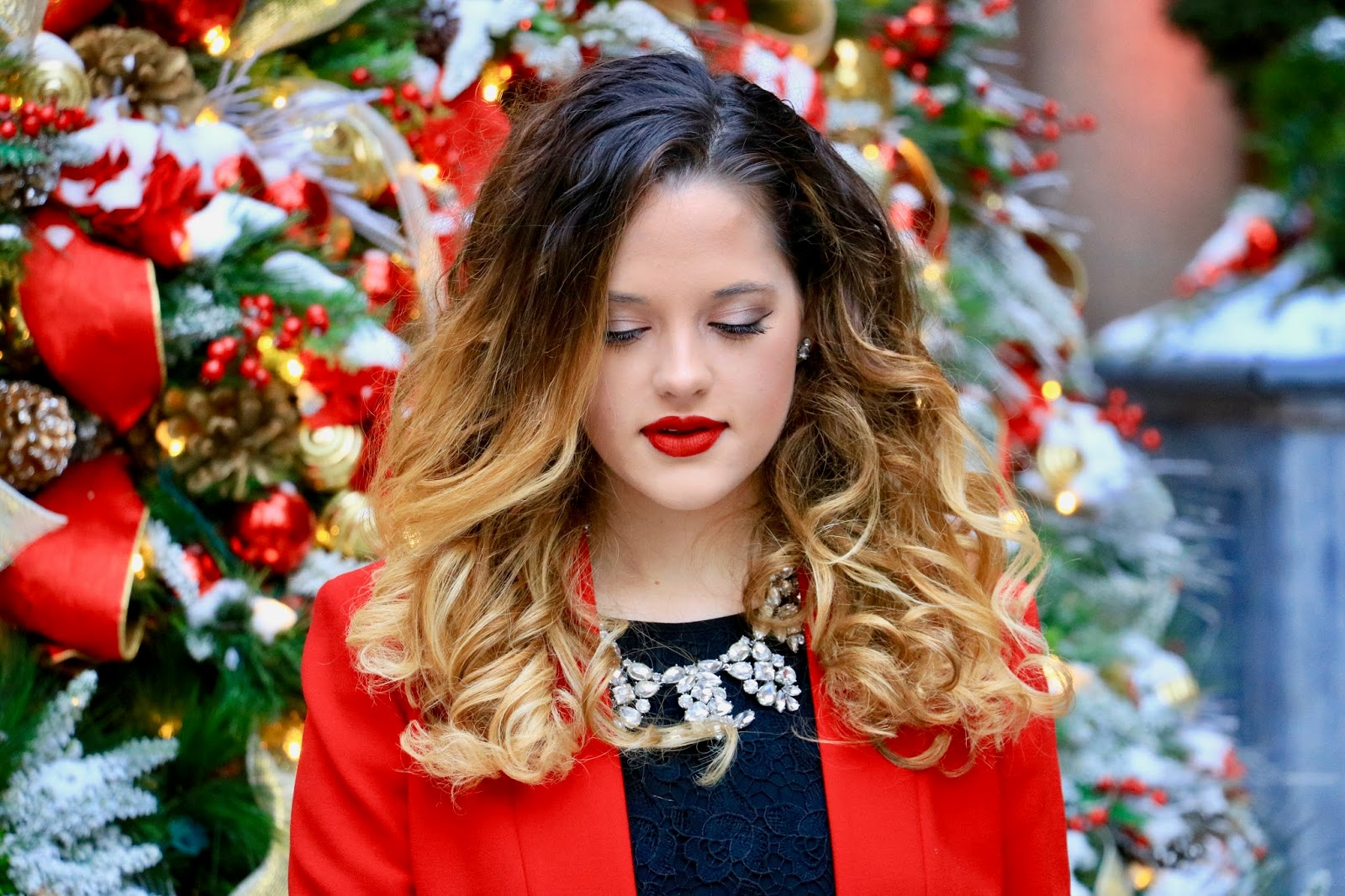 Nyc beauty blogger Kathleen Harper wearing holiday makeup with a red lip