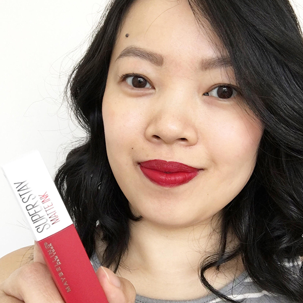 Vancouver-based beauty, life and style blogger Solo Lisa wears Maybelline Super Stay Matte Ink Liquid Lipstick in Pioneer, a classic cherry red