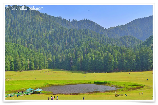 Beautiful Khajjiar Lake Backdrop of Hills covered with Deodar Trees