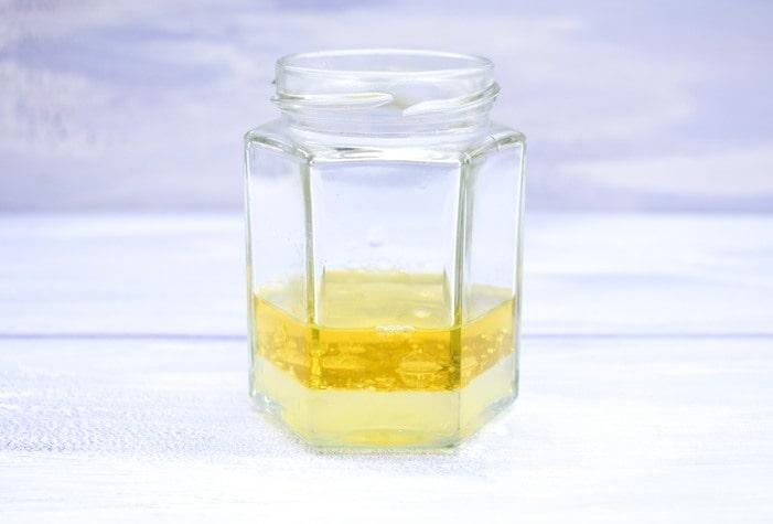 jam jar with oil and lemon juice