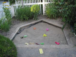Sandbox shaped like pentagon.