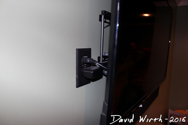 wire tv through wall, outlet box behind tv, tv wires in wall, mount