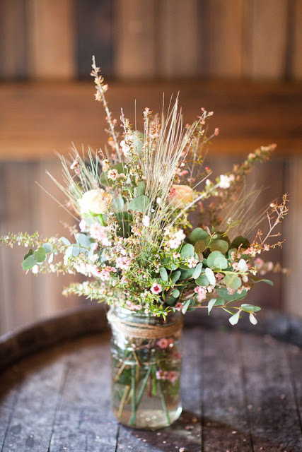 rustic Mason jar centerpiece with wildflowers